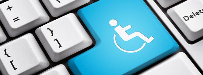 """Imagem mostra teclado de um computador em close na tecla """"enter"""" sinalizada pelo símbolo de acessibilidade."""